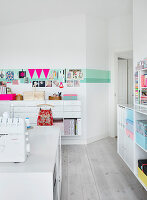 organization and storage ideas in the white craft room