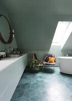 Long white vanity unit in attic bathroom