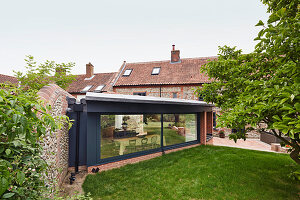 View from the garden of the Farmhouse extension into the open plan kitchen