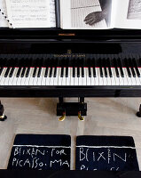 Carpets with handwritten print in front of the piano