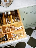 organized opened cutlery drawer
