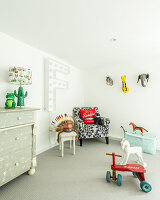 Chest of drawers, animal figurines and Native American headdress in child's bedroom
