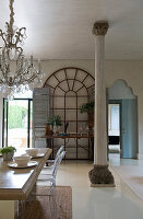 Antique pillar and arched windows in Mediterranean dining room
