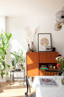 Tall sideboard in mid-century style in sunny dining room