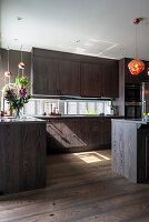 Elegant kitchen with dark wooden fronts