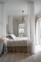 Romantic, Scandinavian-style bedroom with canopy