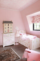 Classic girl's bedroom in attic decorated entirely in pink