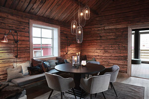 Pleasant and elegant dining room in rustic wooden cabin