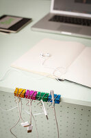 Colourful binder clips repurposed as cable organiser