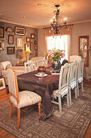 French-style dining room with gallery of vintage pictures