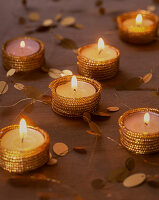Golden tealight holders as festive table decorations