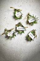 Christmas place cards made from rosemary circlets
