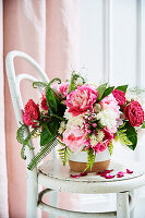 Pink and white floral bouquet with roses, peonies and fern leaves