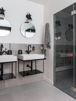 Bathroom for two with shower area and grey tiles