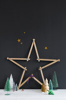 Christmas star made from folding rule against black wall