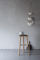 Set of hanging bowls and stool
