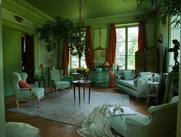 Antique armchairs, sofa and chaise longue in green French parlour