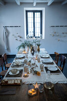 Place mats made from tree bark on festively set dining table