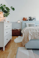 Cosy bedroom in pale blue and white