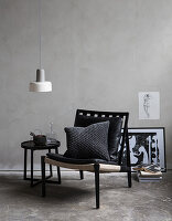 Masculine seating area against grey wall on concrete floor
