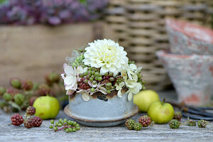 Autumn arrangement with dahlia, hydrangea blossoms and unripe berries