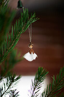 Christmas angel handmade from natural materials hanging from Christmas tree