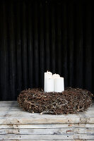 Four white candles in rustic wreath
