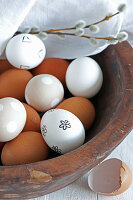 Blown white eggs decorated with stamped motif