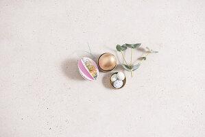 Easter arrangement: gilt egg, origami egg and sugar eggs
