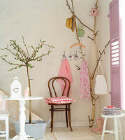 Birch branch used as coat stand in summery foyer