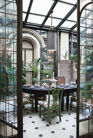 Festively set table in restored Florentine conservatory