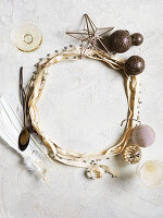 Christmas table decoration with baubles, ribbon and decorative stars