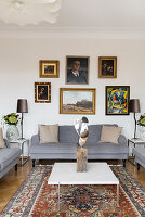 Gallery of pictures above grey sofa in classic living room