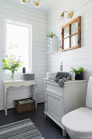 Small country-house-style bathroom with white board walls