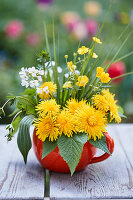 Spring posy of dandelions, buttercups, lady's smock, ribwort plantain, cleavers and grasses