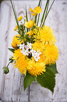 Spring posy of dandelions, buttercups, lady's smock, cleavers and grasses