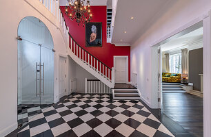 Chequered floor and chandelier in spacious foyer