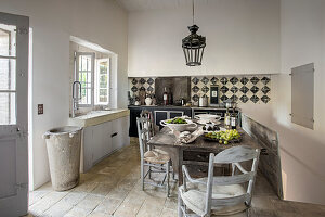 Dining table in rustic kitchen in French country house