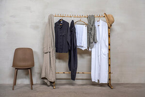Bamboo cloths rail next to chair