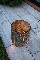 DIY tree-stump lamp in style of Swedish fire torch