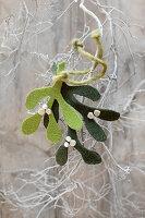 Festive arrangement of green felt mistletoe sprigs