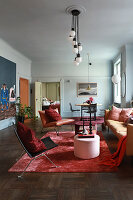 Glamorous living room with pale blue walls and furnishings in various shades of red