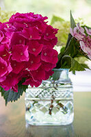 Glass vase of hydrangeas