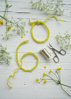 Cow parsley, buttercups and number 60 made from wire wrapped in felt ribbon