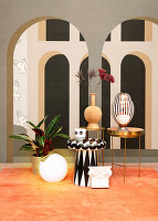Sire tables against mural wallpaper with architectural motif