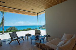 Living room with window bay in modern, architect-designed house with sea view
