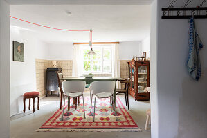 View into dining room in cosy eclectic style
