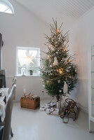 Vintage-style Christmas tree in white dining room