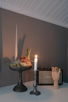 Wintry arrangement of succulents and candle