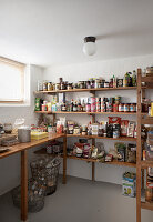 Groceries on simple wooden shelves in cellar